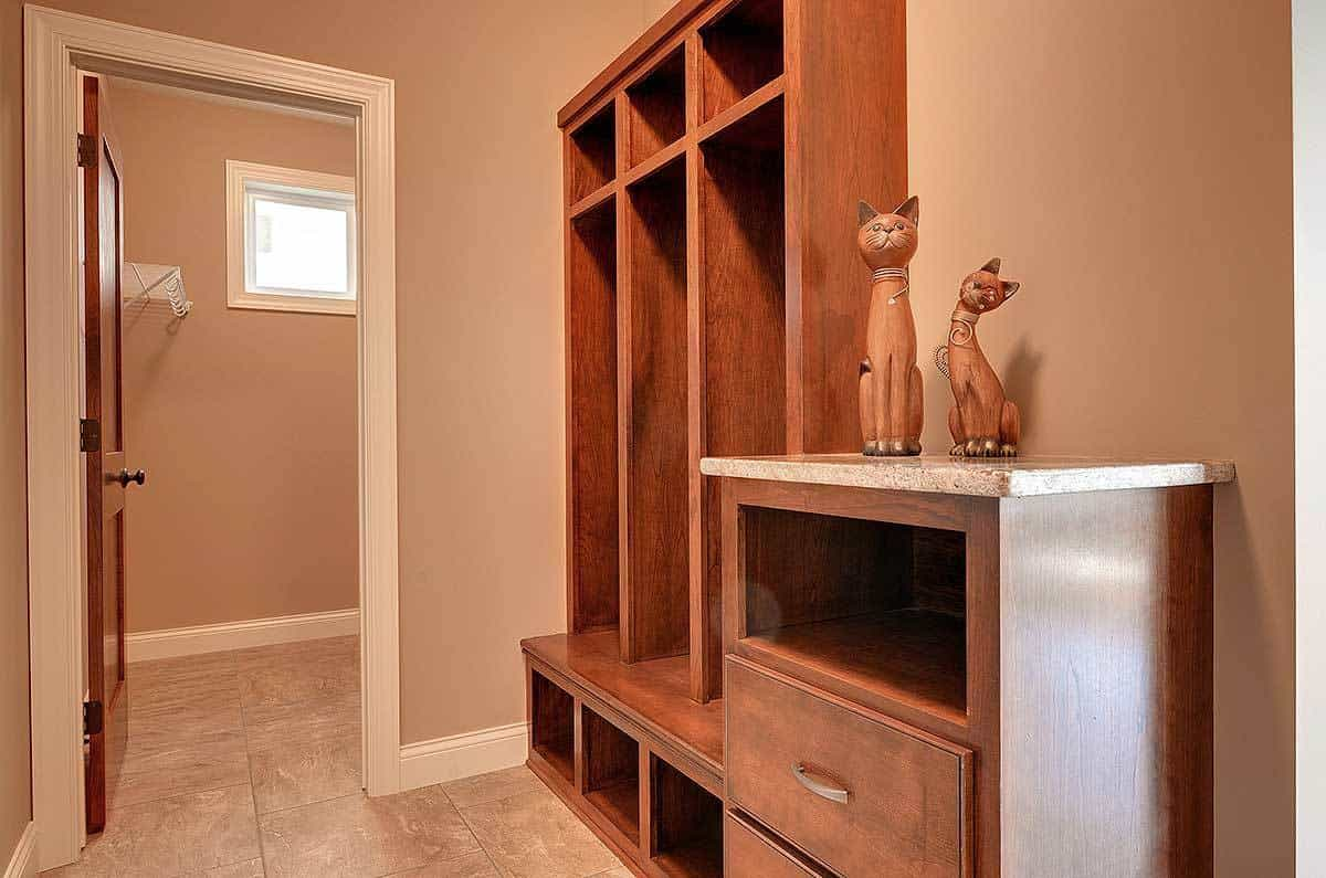This area features wooden storage and a granite top counter decorated with lovely cat sculptures.