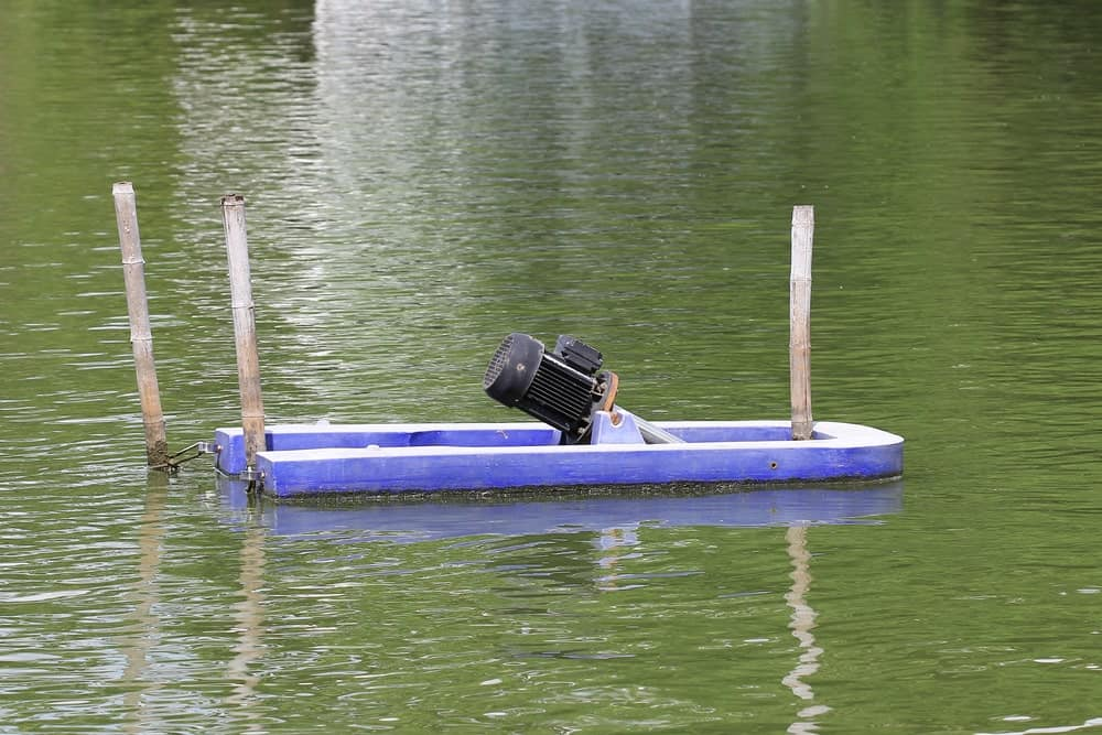 A submersible sump pump on water.