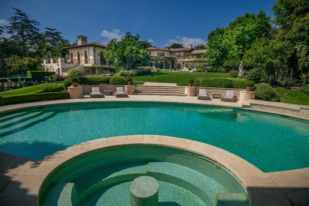 This view of the house showcases its gorgeous exterior and its courtyard leading to the house's entry. Images courtesy of Toptenrealestatedeals.com.