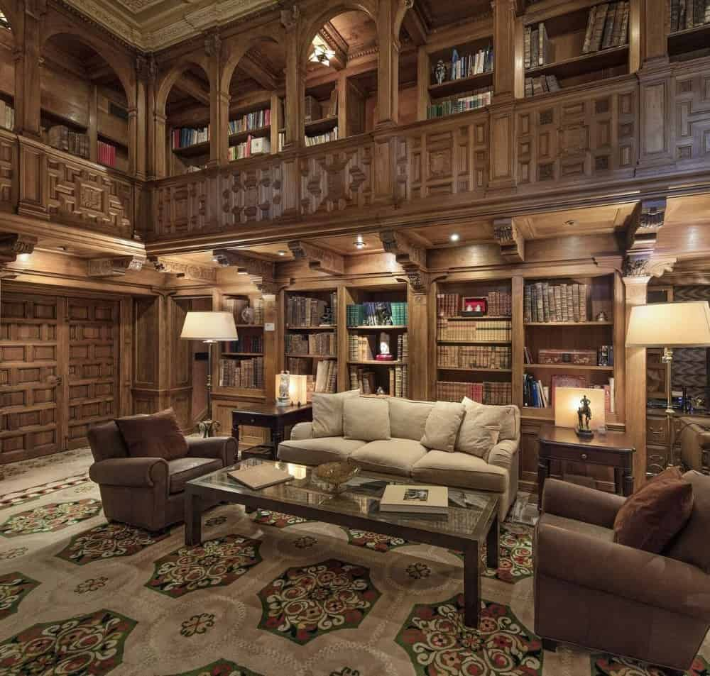 Another look at this living space with a two-storey library featuring a cozy sofa set and the bookshelves filled with books. Images courtesy of Toptenrealestatedeals.com.