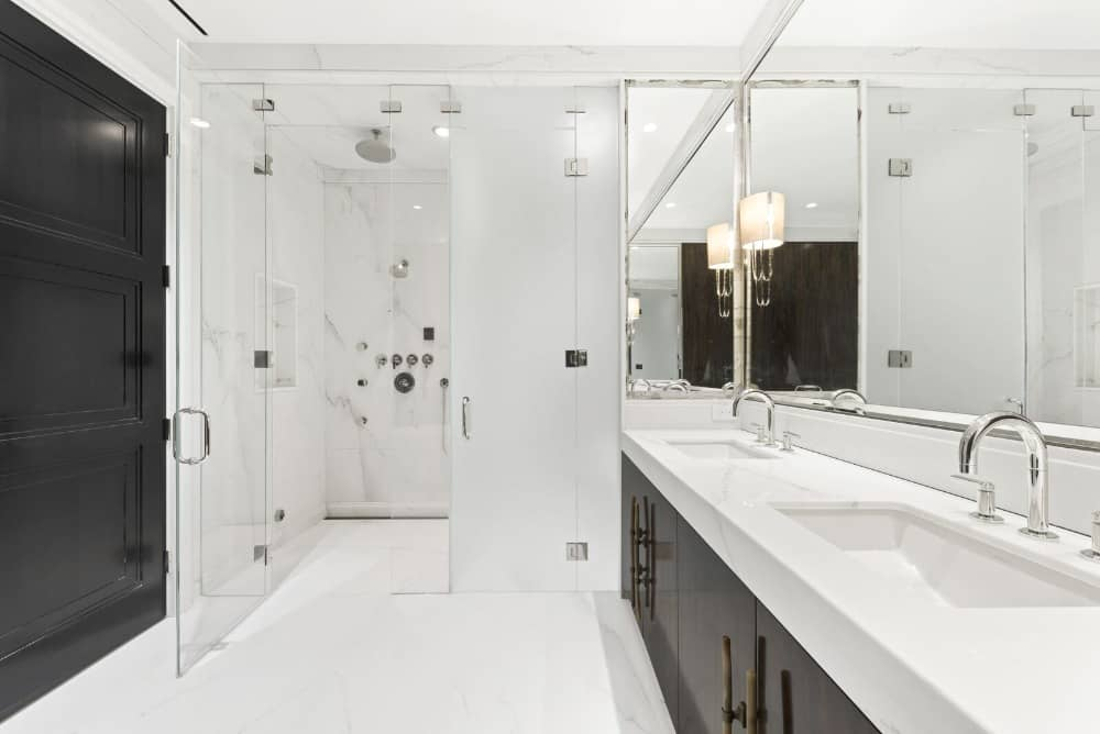 This bathroom features a walk-in shower room and a white sink counter. Images courtesy of Toptenrealestatedeals.com.
