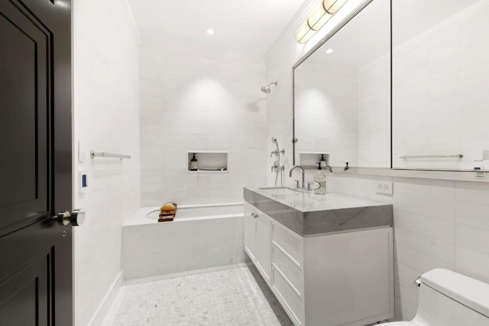 Another bathroom with a bathtub and shower combo along with a single sink counter. Images courtesy of Toptenrealestatedeals.com.