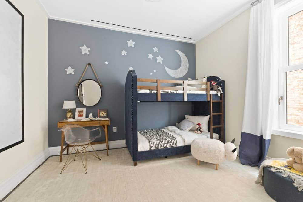 Another kids bedroom with a stylish wall and a modern bunk bed along with a study desk and chair set on the side. Images courtesy of Toptenrealestatedeals.com.