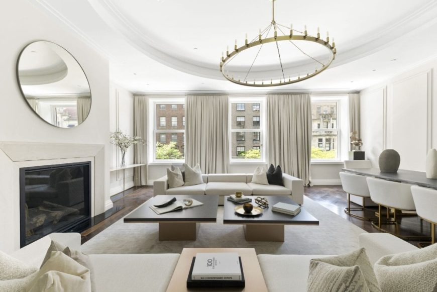 Large formal living room featuring a cozy sofa set, two modern center tables and a fireplace. Images courtesy of Toptenrealestatedeals.com.