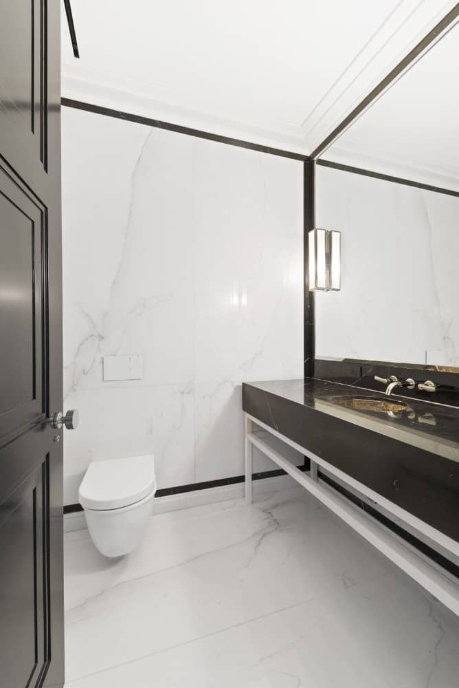 Here's a toilet room inside the bathroom with its own sink counter. Images courtesy of Toptenrealestatedeals.com.