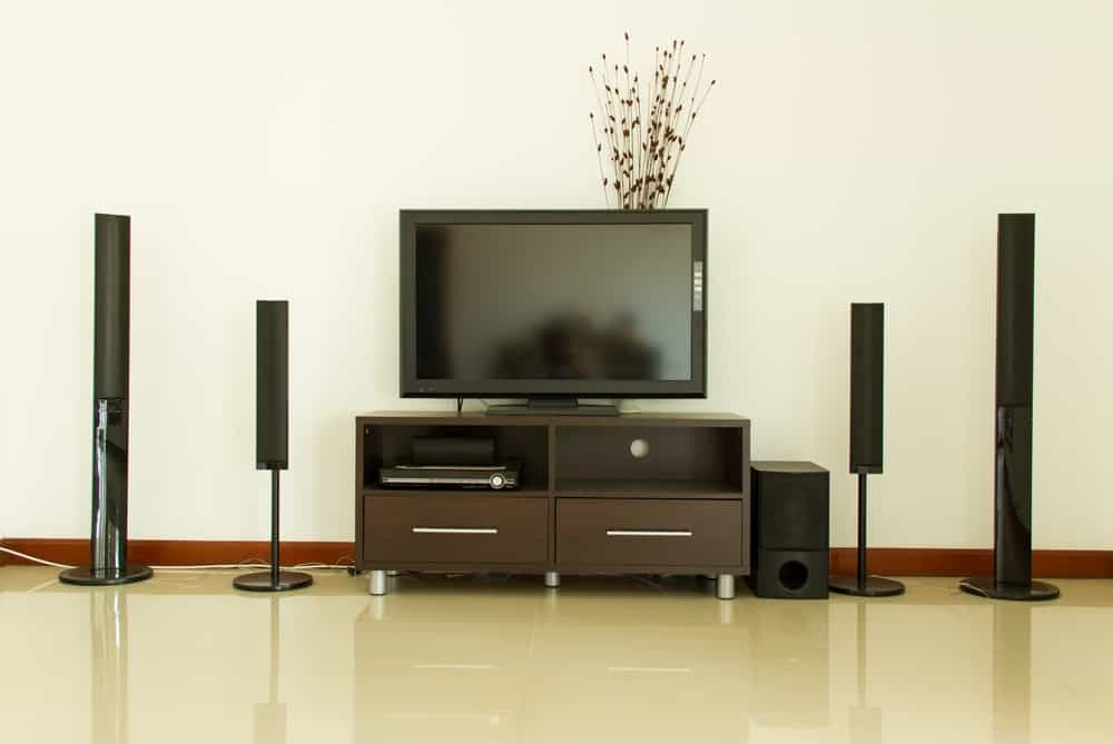 A modern entertainment system set-up on a white wall.