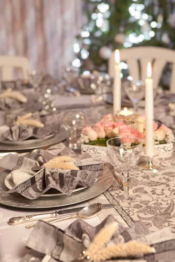 A close-up of a table setup with beautiful silver plates.