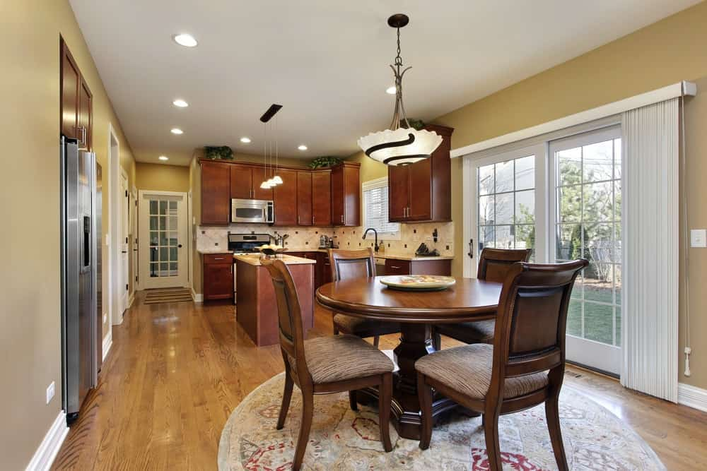 Kitchen in suburban home with a wooden round table.