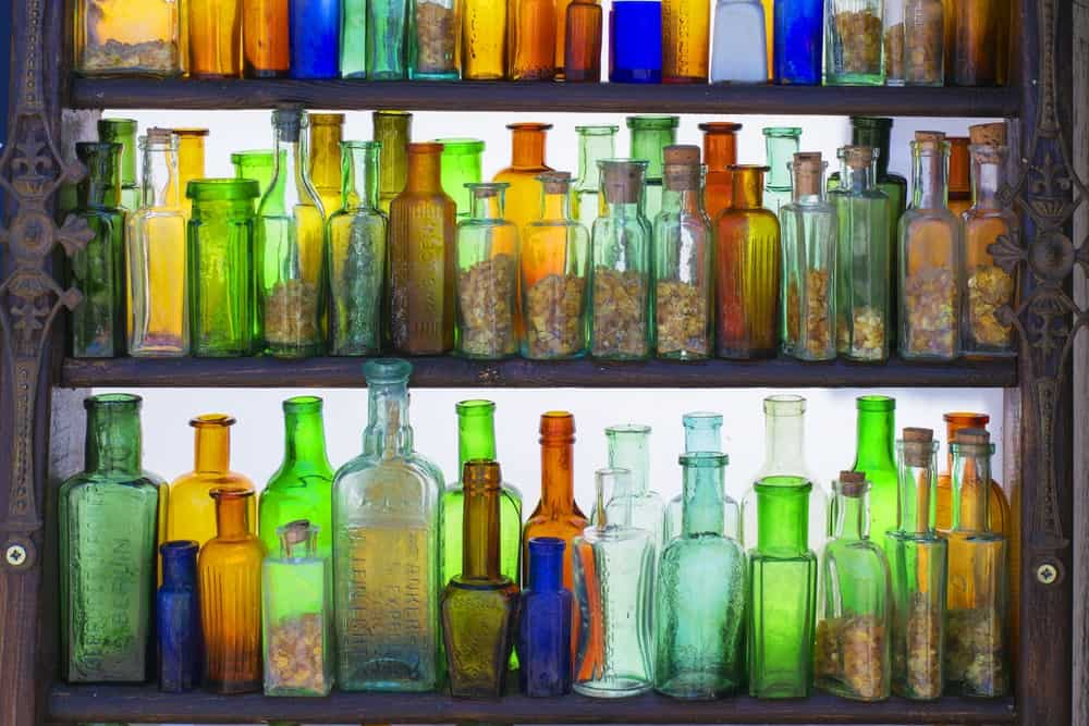 A collection of colorful old bottles on shelves.