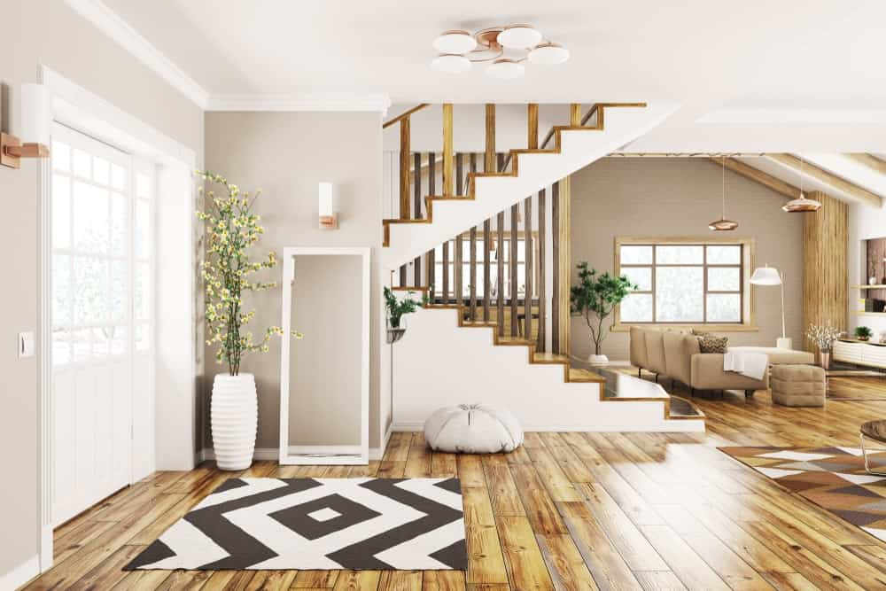 A charming foyer with a black and white area rug to match the walls.