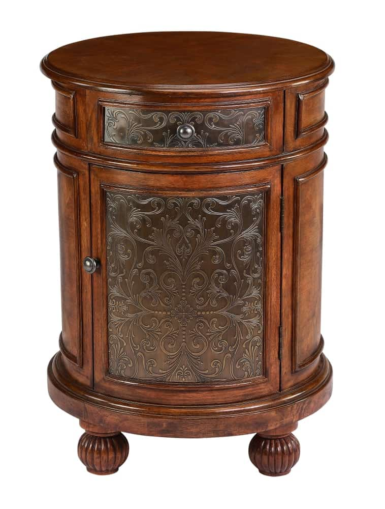 A beautiful small decorative cabinet with carvings.