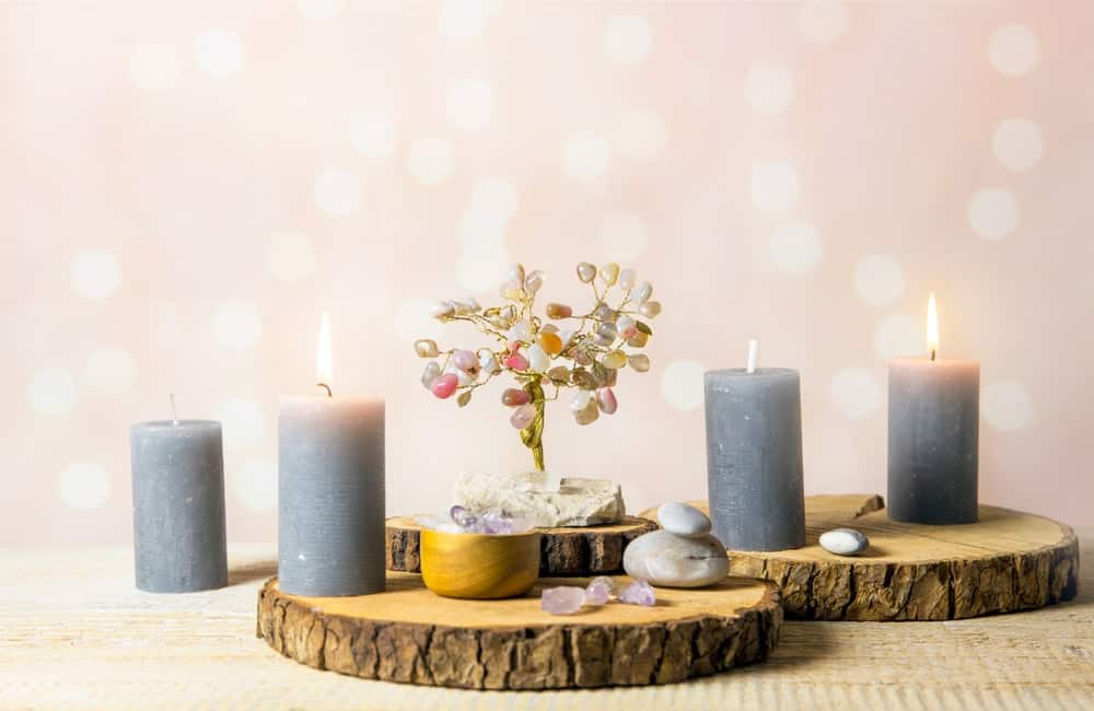 A decorative setup of candles and wood.