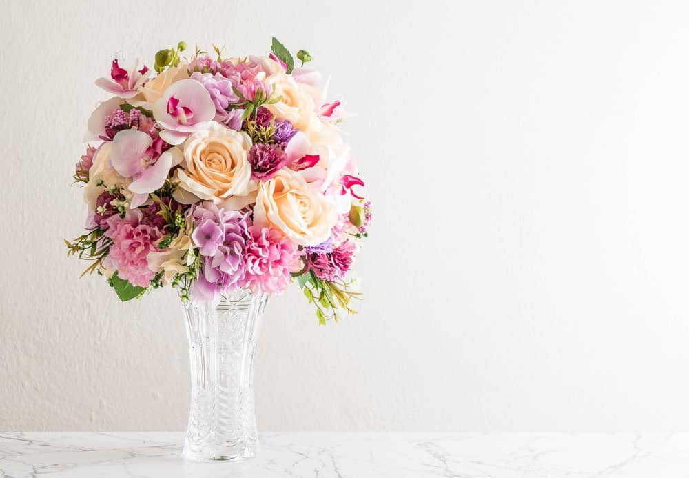 A beautiful bouquet of flowers placed in a glass vase.