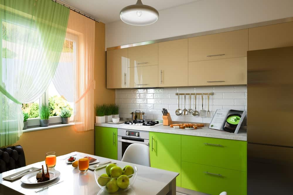 A simple and small kitchen complemented by its green accent.