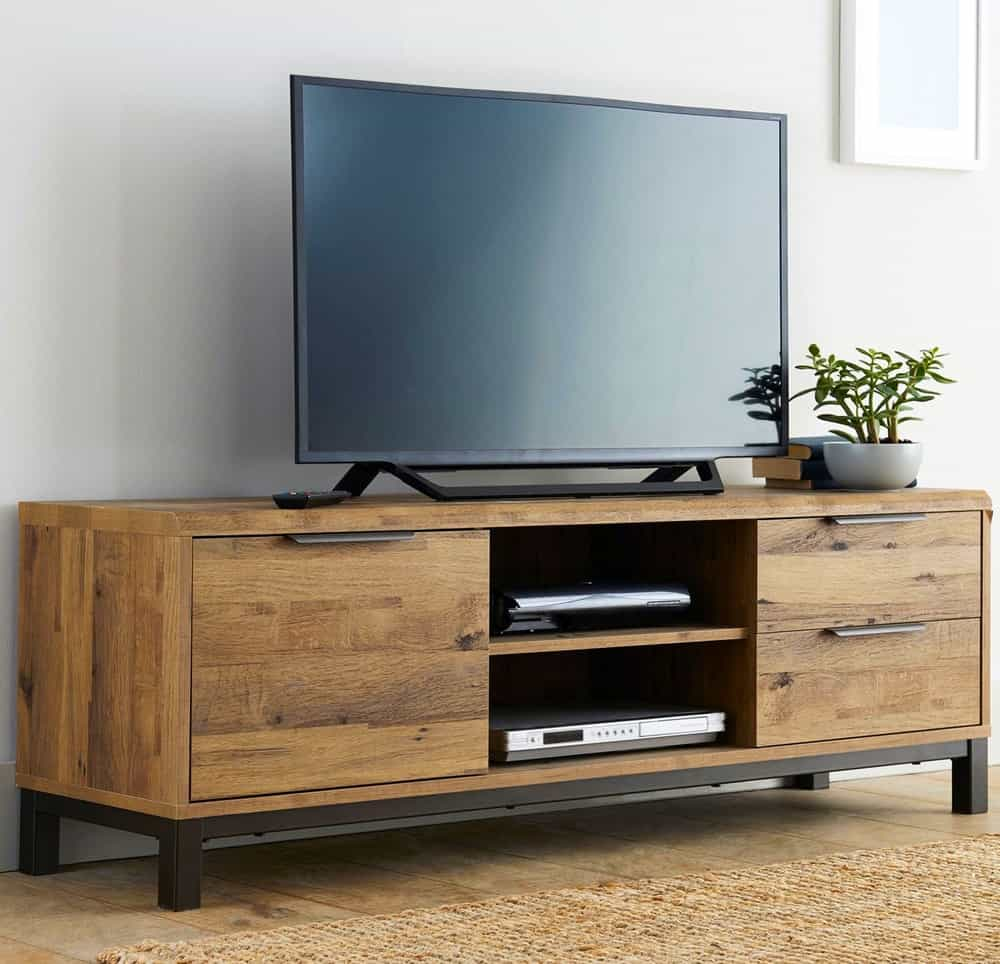 A close-up of an entertainment system on a wooden TV cabinet, neat without any cables in view.