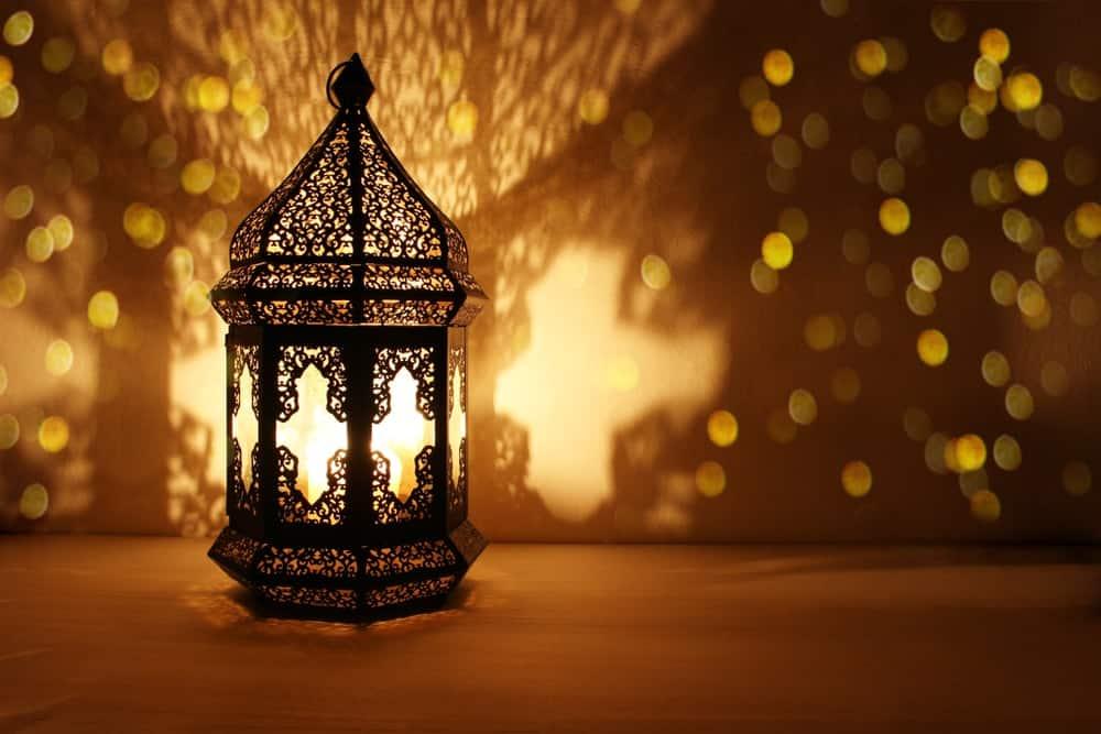 A Mediterranean-style lantern with yellow light.