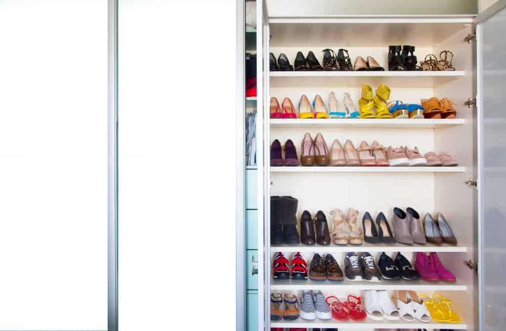 A large and luxurious cabinet filled with shoes.