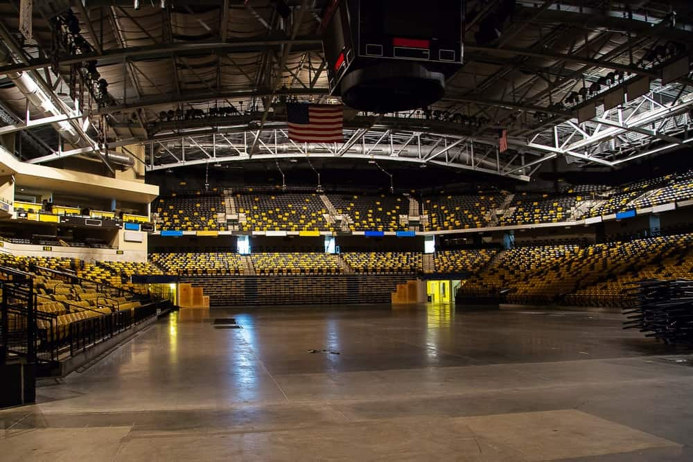 An empty stadium and basketball court.