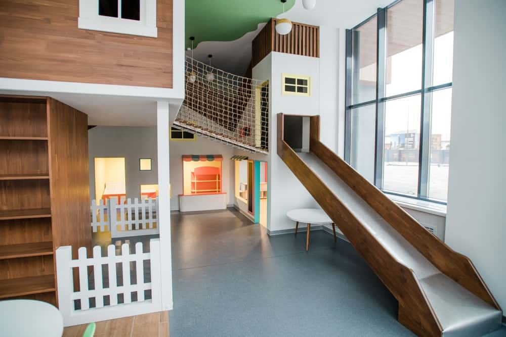 An impressive full-sized indoor playroom with a large slide.