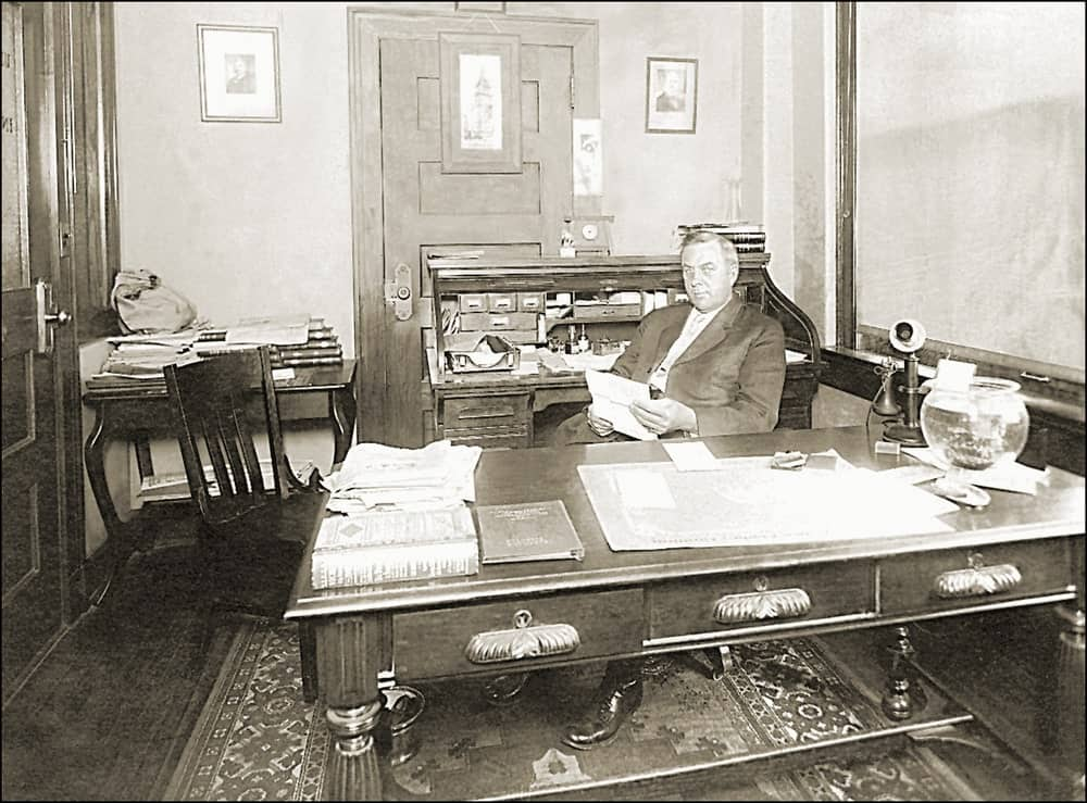 VIntage photo of a banker in his office.
