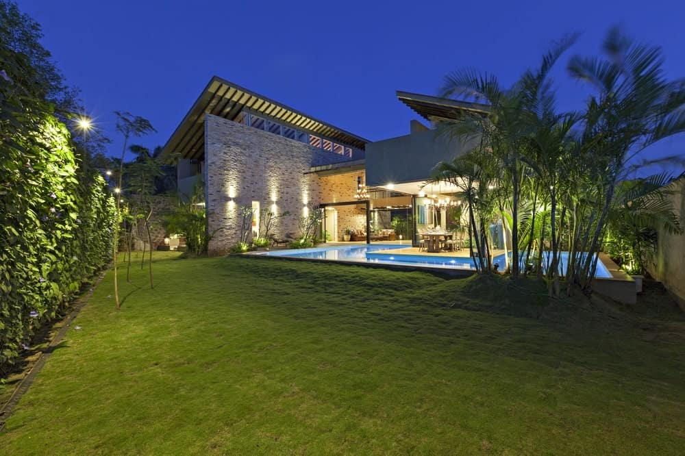 Backyard swimming pool in the Monsoon Retreat designed by Abraham John Architects.