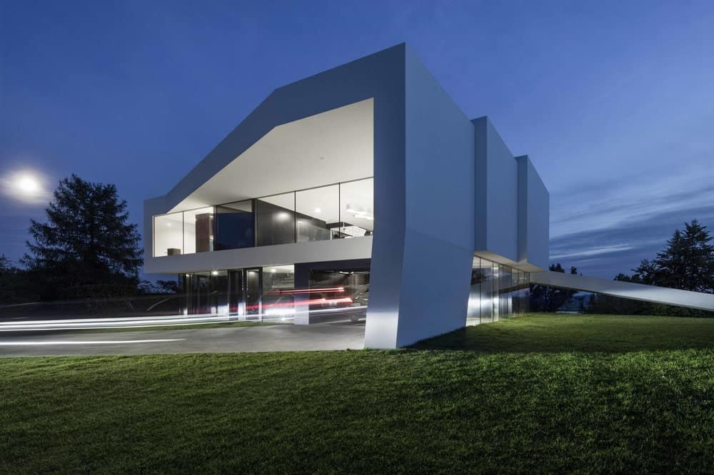 Exterior's night view of the By The Way House designed by Robert Konieczny KWK Promes.