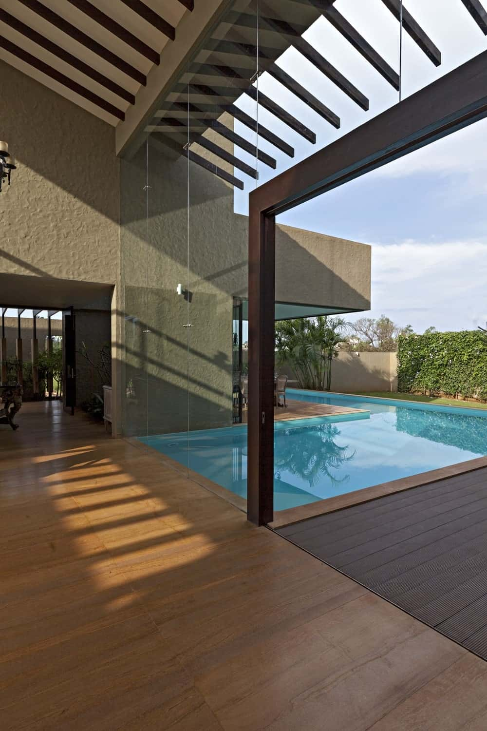 Swimming pool deck in the Monsoon Retreat designed by Abraham John Architects.