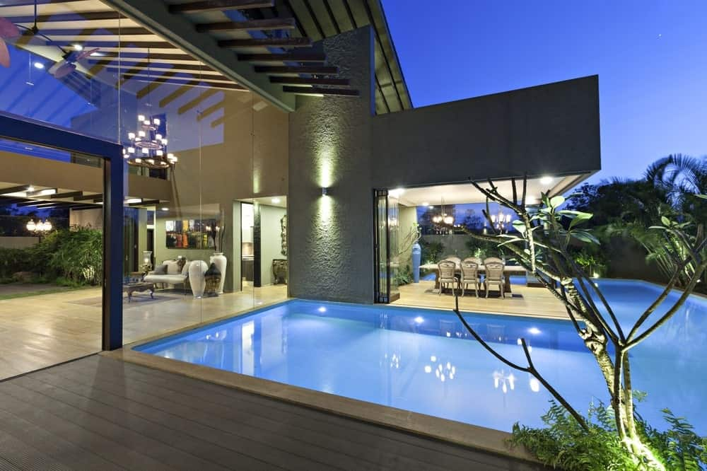 Night view of the wraparound pool in the Monsoon Retreat designed by Abraham John Architects.