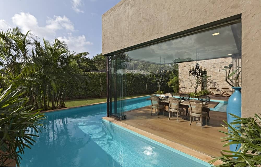 Dining area by the pool in the Monsoon Retreat designed by Abraham John Architects.