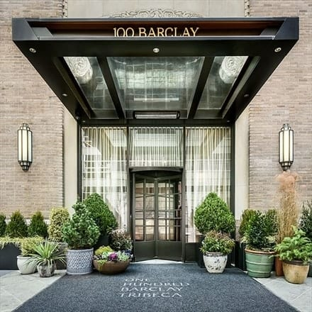 This is the main entry of 100 Barclay with a rotating glass door flanked by potted plants that give a warm welcome to the main entry. Images courtesy of Toptenrealestatedeals.com.