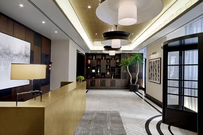 This is the lobby of 100 Barclay with a large reception area and built-in desk across from the rotating glass doors. Images courtesy of Toptenrealestatedeals.com.