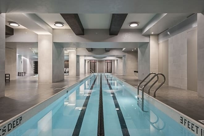 The penthouse also has its own large indoor swimming pool with beige walls and beige ceiling that has exposed beams matching the thick pillars. Images courtesy of Toptenrealestatedeals.com.