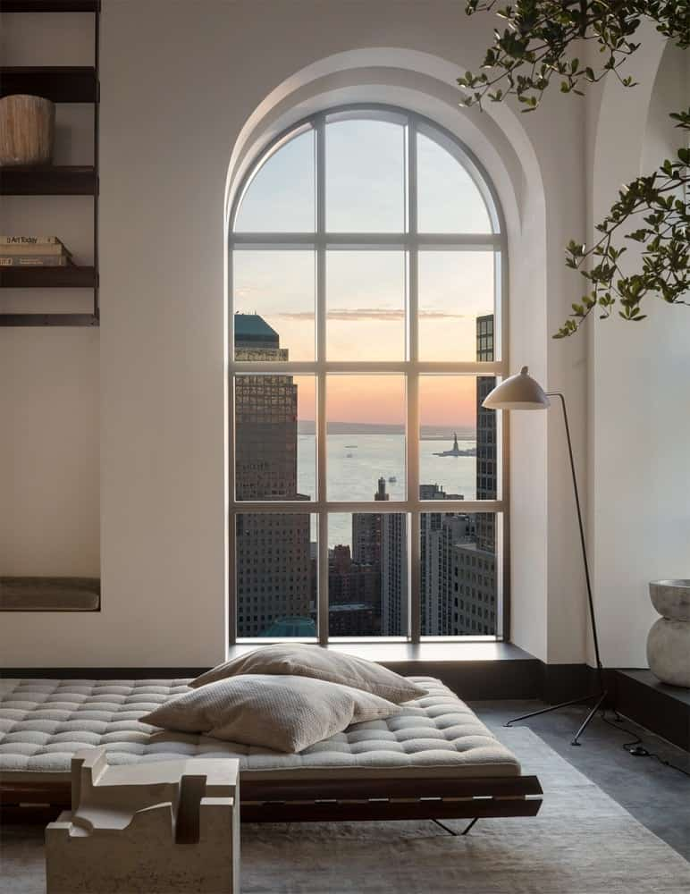 This is a lovely reading nook beside an arched window offering a scenic skyline view outside. This is paired with a cushioned day bed placed near the window to maximize the natural lighting. Images courtesy of Toptenrealestatedeals.com.