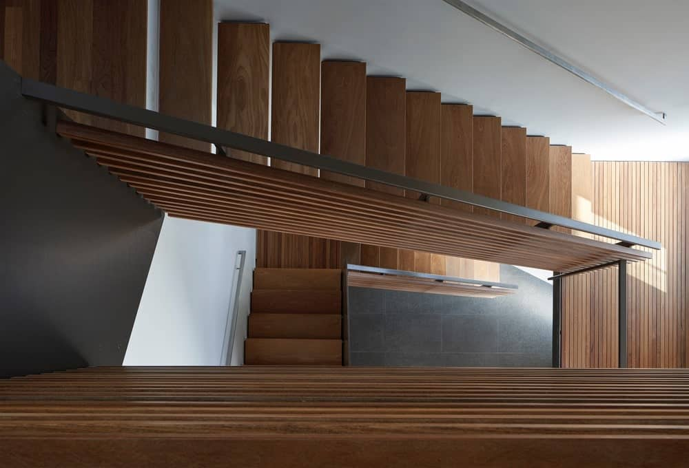 Wooden staircase in the House on Hillside designed by Terry & Terry Architecture.