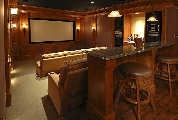 Home theater with stadium seating and projector screen.
