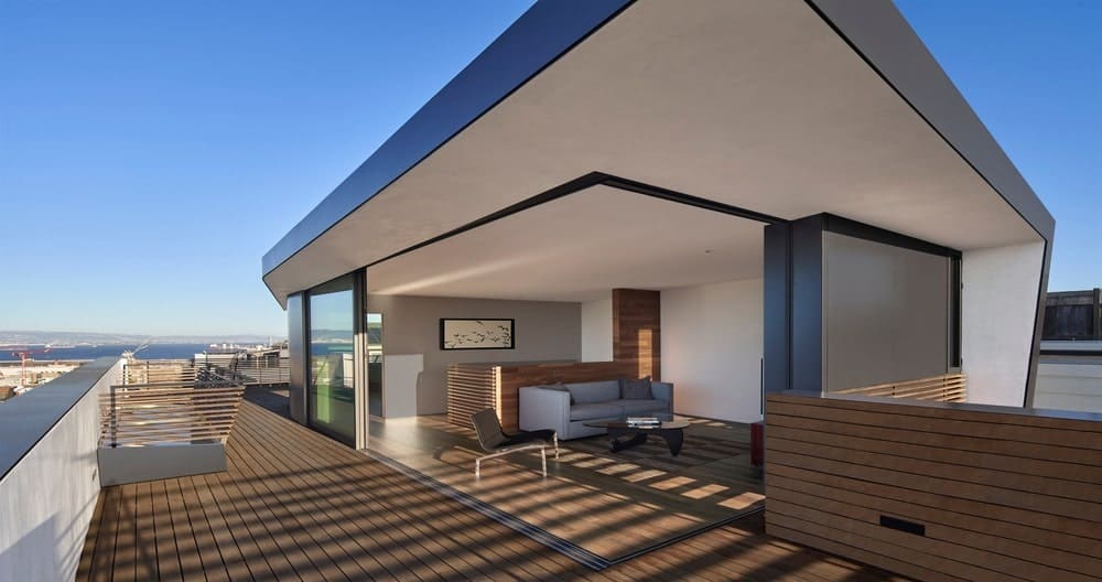 Upper patio and deck in the House on Hillside designed by Terry & Terry Architecture.
