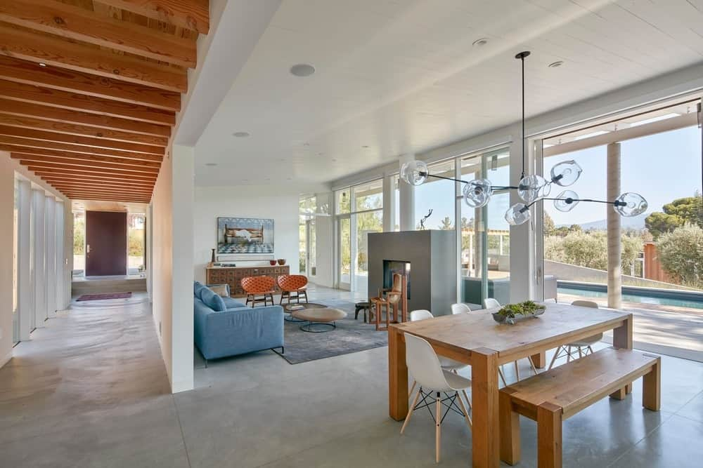 Shared living and dining space in the Modern-Day California Ranch House designed by Malcolm Davis Architecture.
