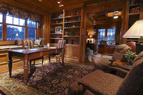 Gorgeous study and home library with windows and built-in shelves.
