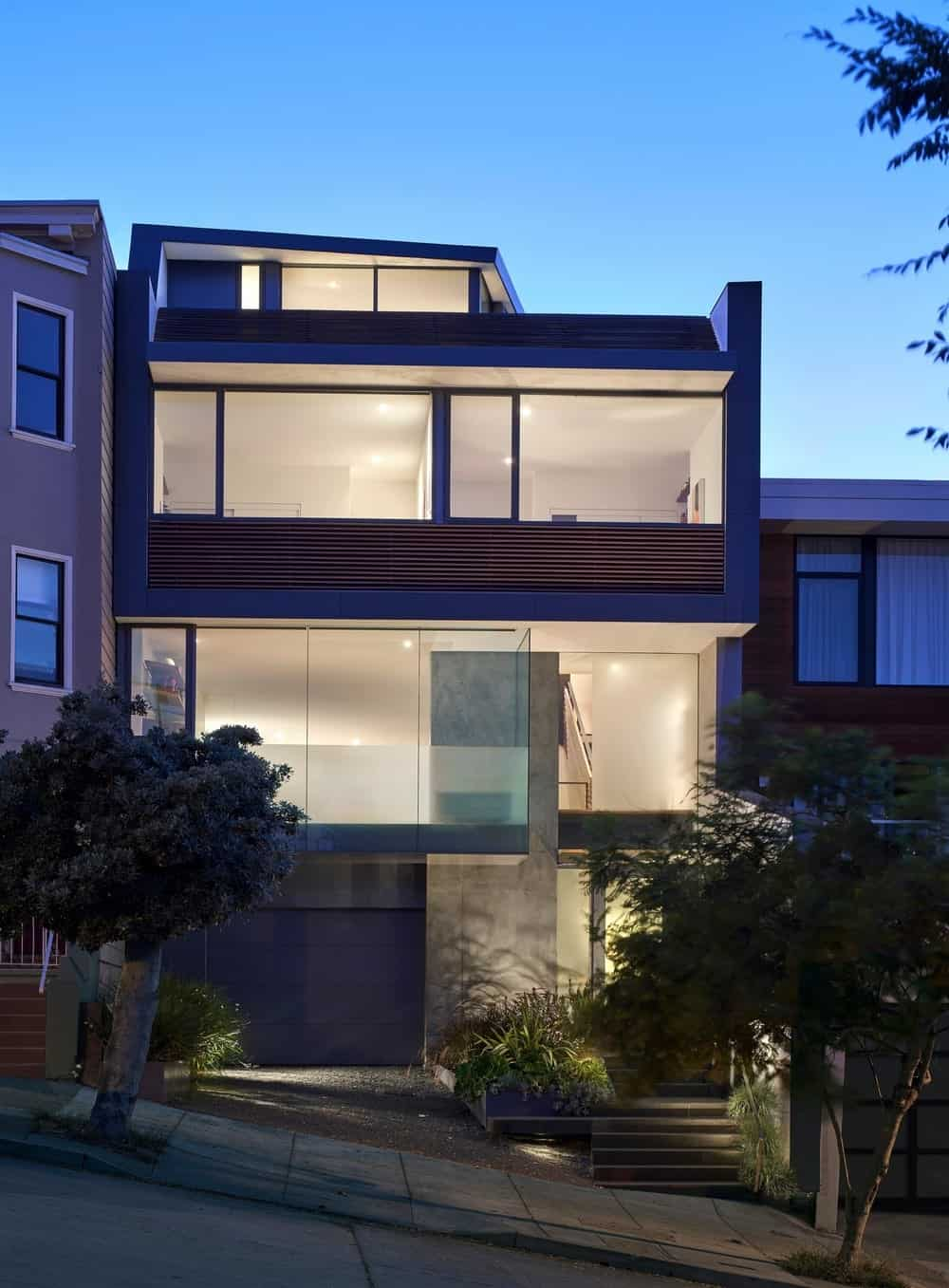 Night view of facade of the House on Hillside designed by Terry & Terry Architecture.