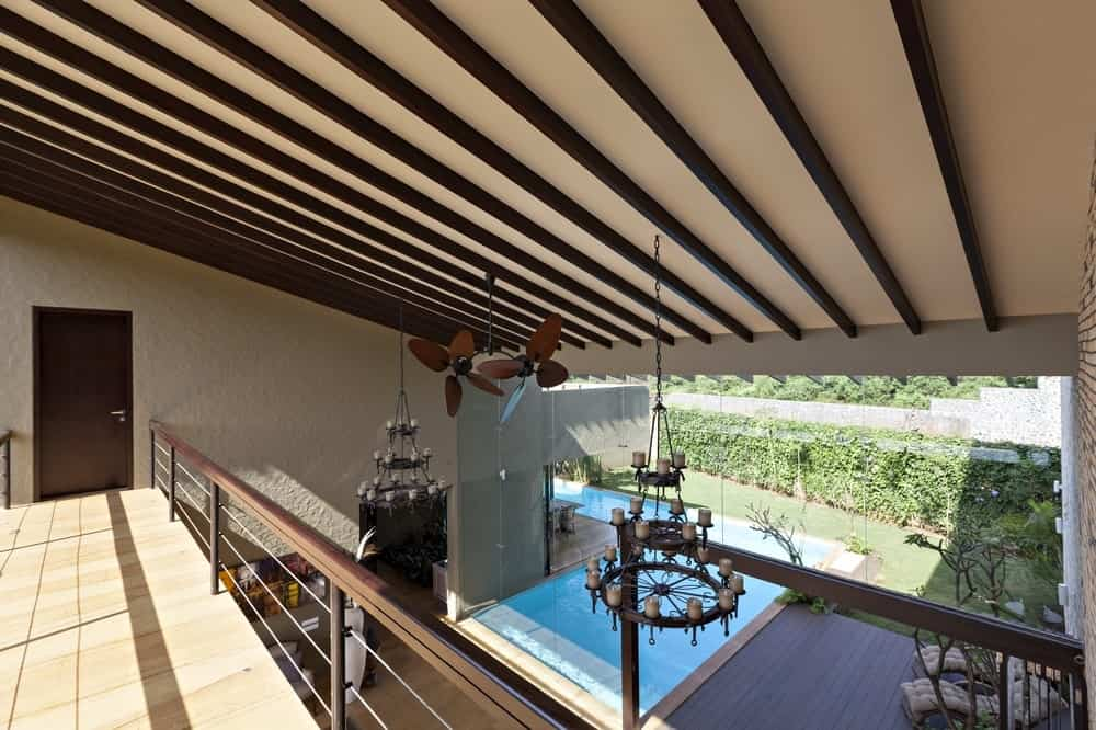 Second-floor balcony in the Monsoon Retreat designed by Abraham John Architects.
