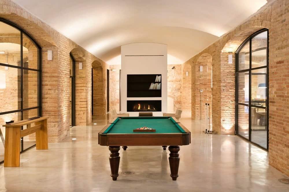 Game room in the Casa Burés designed by Estudio VILABLANCH + TDB Arquitectura.