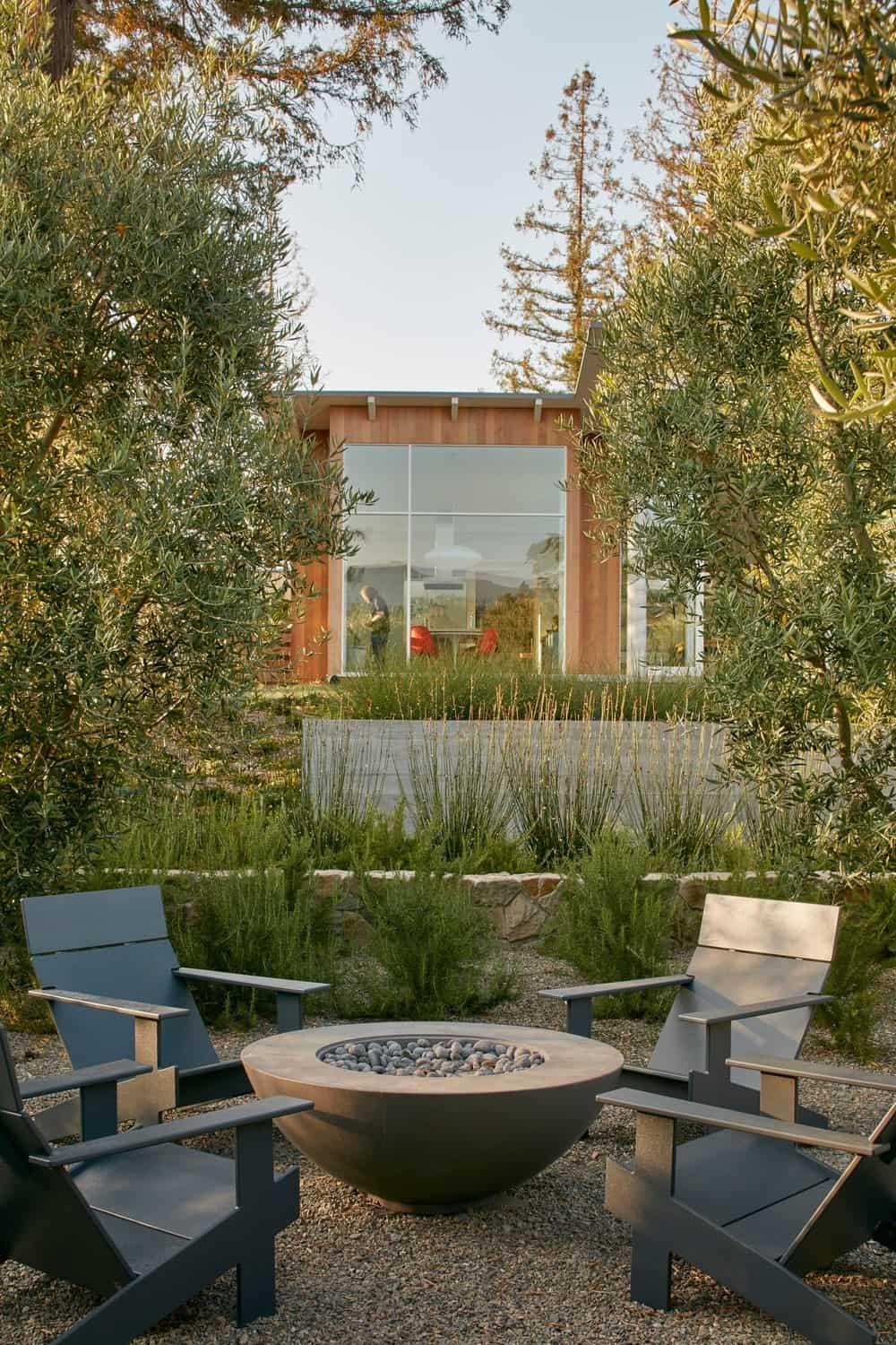 Outdoor fire pit seating in the Modern-Day California Ranch House designed by Malcolm Davis Architecture.