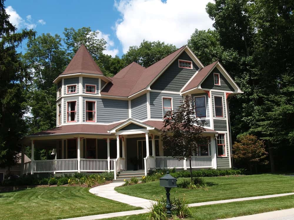 Exterior of a 2-story Victorian home with a front lawn and walkway.