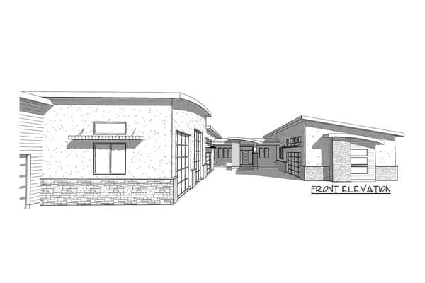 This is the front elevation of the home that features its unique U-shape to give enough space for the driveway of the seven-car garage and RV storage.