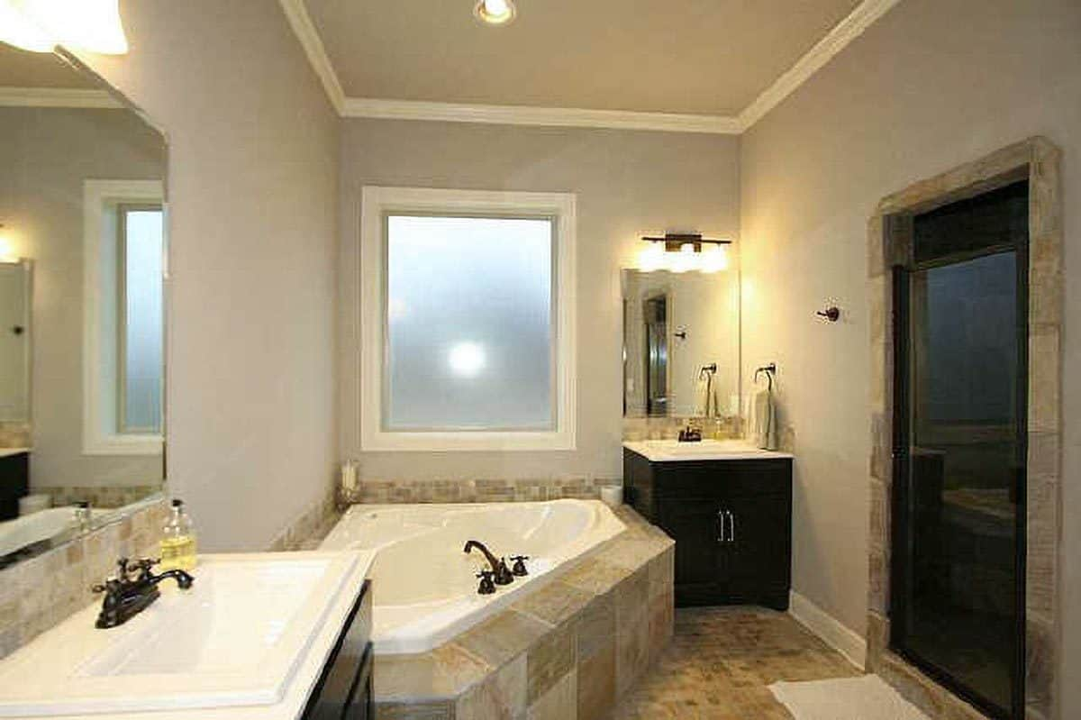 There's also a walk-in shower and a corner tub nestled in between dark wood washstands.