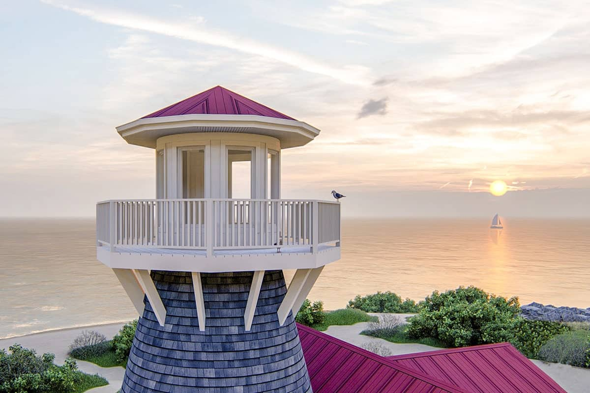 The lookout tower is framed with white railings while providing an unobstructed view of the stunning ocean.