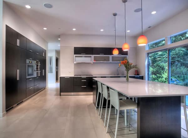 A closer look at the kitchen shows the inset cabinetry fixed against the white walls.