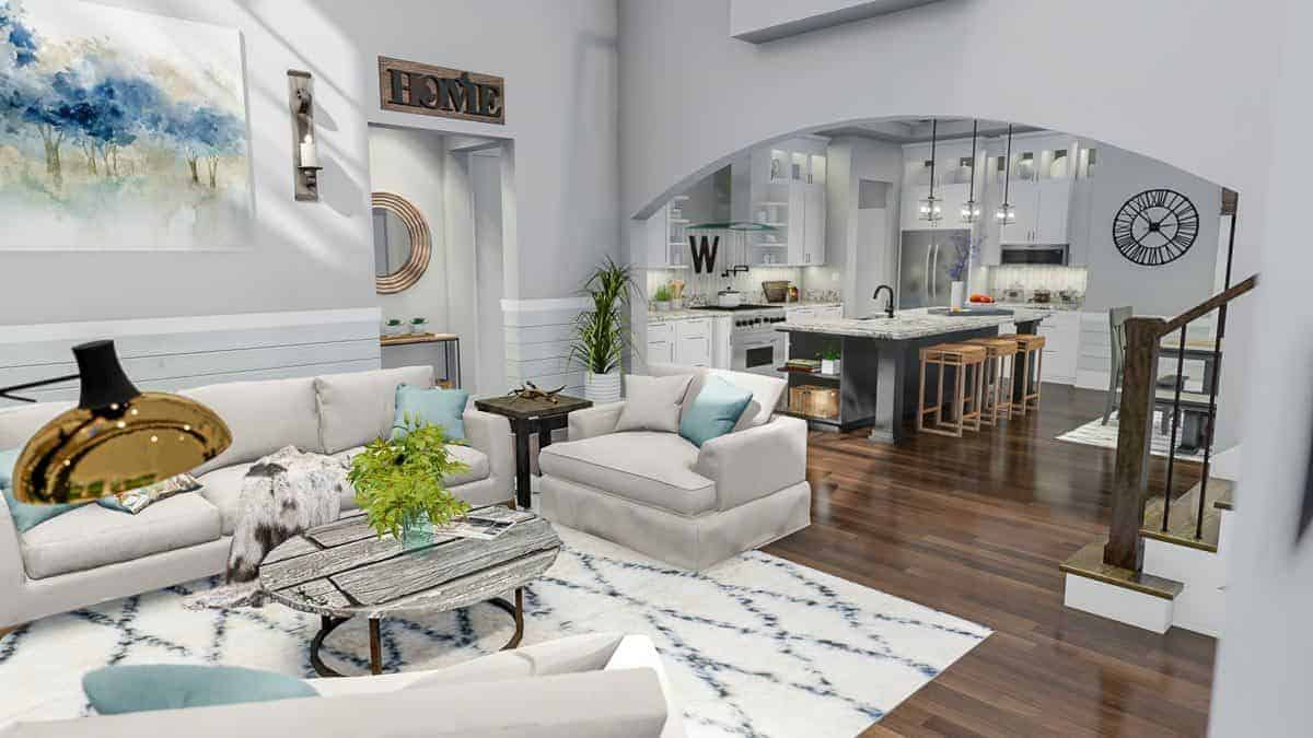 An open layout with the view of the living room along with the kitchen and dining area defined by the archway.