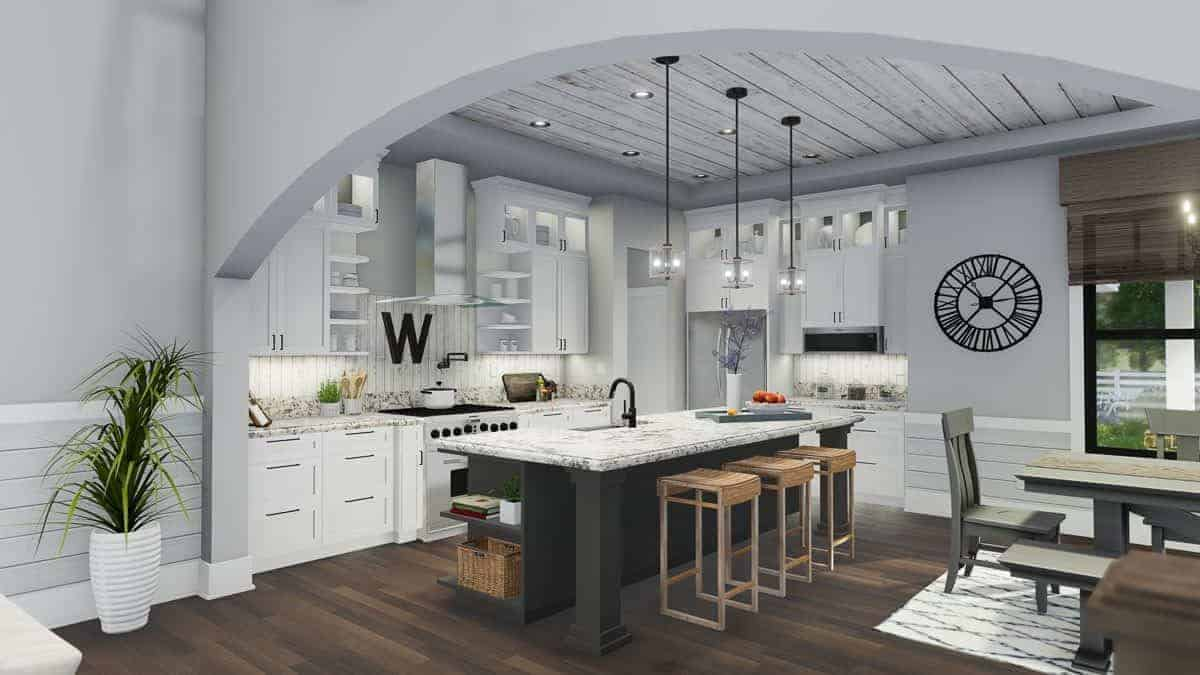 The combined dining and kitchen with dark hardwood flooring and distressed shiplap ceiling mounted with glass pendants and recessed lights.