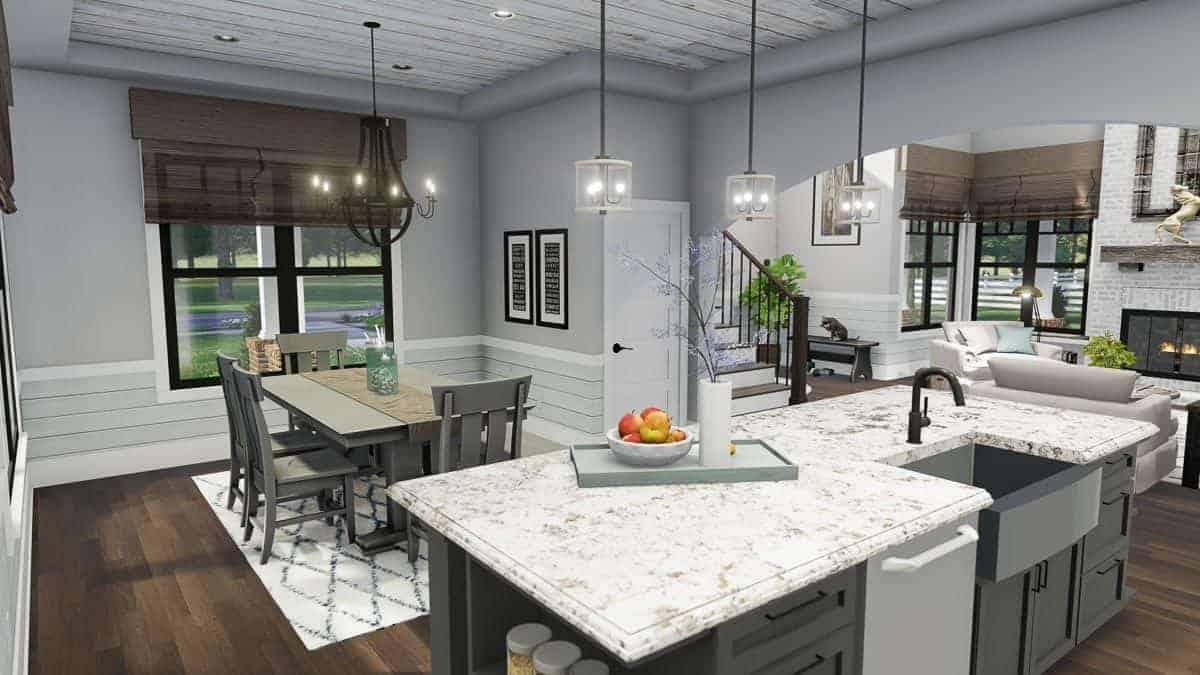 The island bar fitted with a farmhouse sink faces the dining area with a gray dining set illuminated by a wrought iron chandelier.